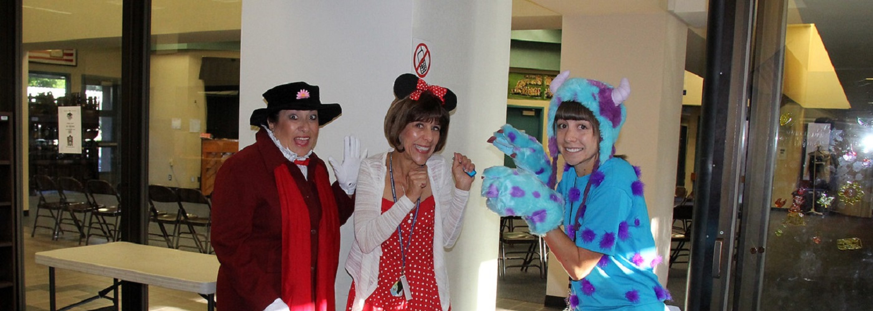 Principal and Teachers Dressed as Disney Characters